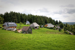 Scenic countryside landscape in the Black Forest: green summer mountain valley with forests, fields and old houses in. Scenic countryside landscape in the Stock Photography