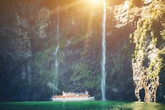 Free Scenic Cruise Approaches Waterfall, Milford Sound. Stock Photography - 118204692