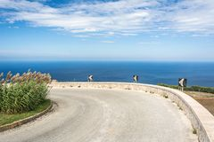 Scenic curvy coastal road with view of the ocean. On Sicily, Italy royalty free stock photography
