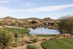 Scenic desert landscape at Arizona golf course. With luxury homes, cactus, native bushes, mountains and rocks stock photo