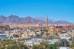 The modern mosque in Sharm El Sheikh, Sinai, Egypt. The scenic desert mountains of Sinai with a view on modern Al Mustafa Al Sahaba Mosque on the foreground royalty free stock photos