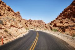 Scenic deserted road, travel concept. Scenic deserted road, travel concept, Valley of Fire, Nevada, USA royalty free stock photography