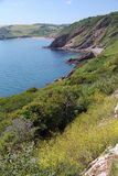 Scenic Devon Coast. Follows the cliff coastal walk from Brixham to Dartmouth, Kingswear in Devon, UK Stock Image