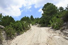 Scenic dirt road in the mountains. Royalty Free Stock Images