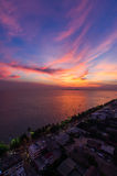 Scenic, Dramatic Sunset over Sea Stock Images