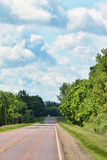 Scenic Drive. A distant car on a scenic drive with a dramatic sky Royalty Free Stock Images
