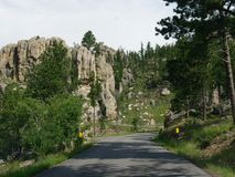 Scenic drive at Needle\'s Highway, South Dakota. Scenic drive along a winding road with dramatic granite formations at Needles Highway in South Dakota royalty free stock photo
