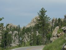 Scenic drive at Needle\'s Highway, South Dakota. Breathtaking drive on winding roads with granite rock formations along Needles Highway in South Dakota stock images