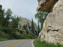 Scenic drive at Needle\'s Highway, South Dakota. Breathtaking drive on winding roads with granite rock formations along Needles Highway in South Dakota royalty free stock photos