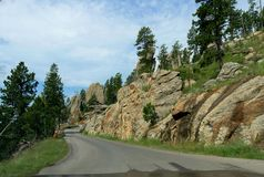 Scenic drive at Needle\'s Highway, South Dakota. Dramatic rock formations at the entrance of the Needle\'s Eye tunnel, one of the best attractions at Needles royalty free stock photo