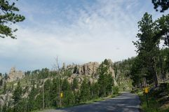 Scenic drive at Needle\'s Highway, South Dakota. Wide scenic drive along a winding road with dramatic granite formations at Needles Highway in South Dakota royalty free stock image