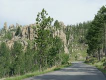Scenic drive at Needle\'s Highway, South Dakota. Winding road with dramatic granite formations at Needles Highway in South Dakota stock photos