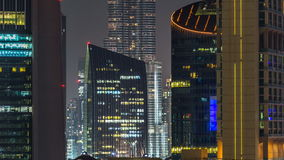 Scenic Dubai downtown architecture at night timelapse. Aerial view of  numerous skyscrapers near Sheikh Zayed road. Scenic Dubai downtown architecture at night stock video footage