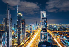 Scenic Dubai downtown skyline. Nighttime cityscape with illuminated skyscrapers and highway Royalty Free Stock Image