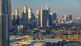 Scenic Dubai downtown skyline timelapse at sunset time. Rooftop view of Sheikh Zayed road with numerous illuminated stock footage