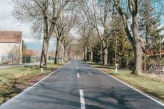 Scenic european countryside road with quality asphalt. On spring season stock photography