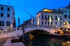 Scenic evening view of bridge over canal, Venice, Italy royalty free stock image