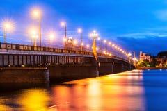 Bridge over Daugava River in Riga, Latvia. Scenic evening view of the illuminated bridge over Daugava River in Riga, Latvia stock image