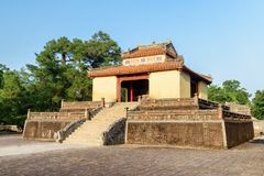 Scenic evening view of Stele Pavilion (Bi Dinh), Hue, Vietnam. Scenic evening view of Stele Pavilion (Bi Dinh) on blue sky background at the Minh Mang Tomb in stock photography