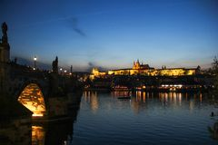 Scenic evening view on Vltava river, Prague castle and historical center of Prague,buildings and landmarks of old town royalty free stock photography