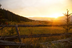 Scenic fall sunset over meadow Royalty Free Stock Image