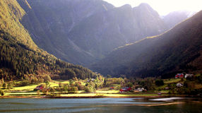 Scenic Fjord. Landscape with mountains and little village in the sunlight, taken in the Sognefjord region of Norway royalty free stock photography