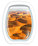 Scenic flight in Dead Valley. Plane window on Dead Valley, Sossusvlei desert in Namib Naukluft National Park, Namibia, from a plane through the porthole. Copy Royalty Free Stock Photos