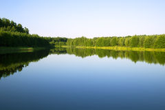 Scenic forests and rivers. Blue sky with the sun over the water and scenic forests and rivers Stock Image