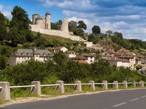 Scenic fortified castle in France. Village with fortified castle in central France Stock Images