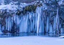 Scenic frozen waterfall Stock Photo