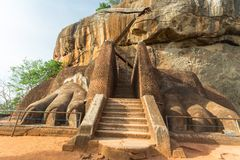 Scenic gate to Sigiriya rock summit. Lion Paws mark the gate to the ancient palace built in the past on the top of Sigiriya rock, the most important historical Royalty Free Stock Photos