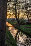 Scenic golden sunset over a canal in Holland royalty free stock images