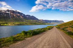 Scenic gravel road along Seydisfjordur fjord in Eastern Iceland Scandinavia royalty free stock photography