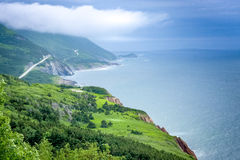 Scenic green lands and road of Cape Breton royalty free stock photo