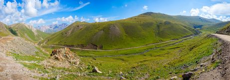 Scenic valley with road, Song Kul. Scenic green valley with road pass, Song Kul, Kyrgyzstan stock image