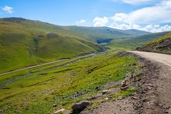 Scenic valley with road, Song Kul. Scenic green valley with road pass, Song Kul, Kyrgyzstan stock photos
