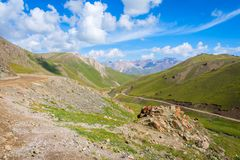 Scenic valley with road, Song Kul. Scenic green valley with road pass, Song Kul, Kyrgyzstan royalty free stock photos