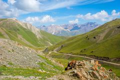 Scenic valley with road, Song Kul. Scenic green valley with road pass, Song Kul, Kyrgyzstan royalty free stock photography