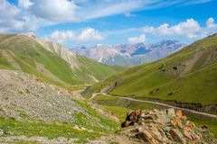Scenic valley with road, Song Kul. Scenic green valley with road pass, Song Kul, Kyrgyzstan royalty free stock photo