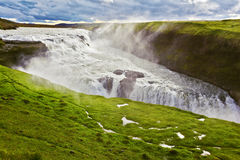 Scenic Gullfoss in Iceland. Water abyss. Over boiling water should cloud splash Royalty Free Stock Photo