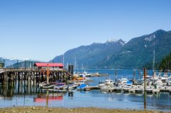 Scenic Harbour under a Clear Summer Sky Stock Photos