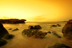 Scenic Hawaiian shoreline with sunset. A scenic Hawaiian shoreline captured in slow shutter during sunset Royalty Free Stock Photography
