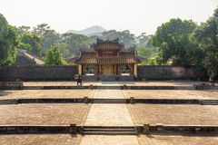 Scenic Hien Duc Gate at the Minh Mang Tomb, Hue. Scenic view of red gilded Hien Duc Gate at the Minh Mang Tomb in Hue, Vietnam. Hue is a popular tourist stock images