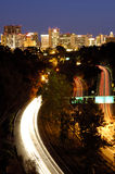 Scenic highway at night. Highway 163 with colorful traffic flow toward San Diego downtown at night Stock Photo