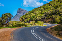Scenic highway. The scenic road on the famous Cape of Good Hope in the Atlantic. Travel to South Africa. The concept of active tourism and recreation stock images