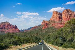 Scenic road to beautiful red mountains in Sedona. Stock Images
