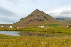 Scenic Hills and Wetlands by an Icelandic Village. Scenic Hills and Wetlands by the Icelandic Village of Arnarstapi royalty free stock images