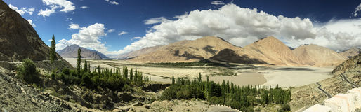Scenic of Himalayas. Panorama view of Himalayas in summer sunny day with white cloud and blue sky Royalty Free Stock Photography