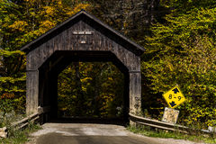 Scenic Historic Covered Bridge and Dirt Road - Vermont Stock Images