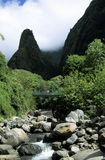 Scenic of Iao Needle, Maui, Hawaii. With stream and rocks in foreground Royalty Free Stock Photography